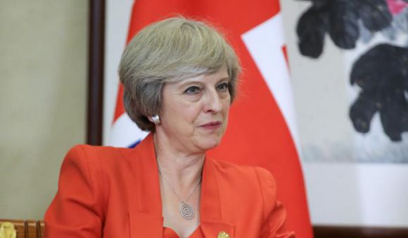 Тереза Мэй (Надела кулон в виде серебряной спирали на встречу с Путиным и на саммит G20)