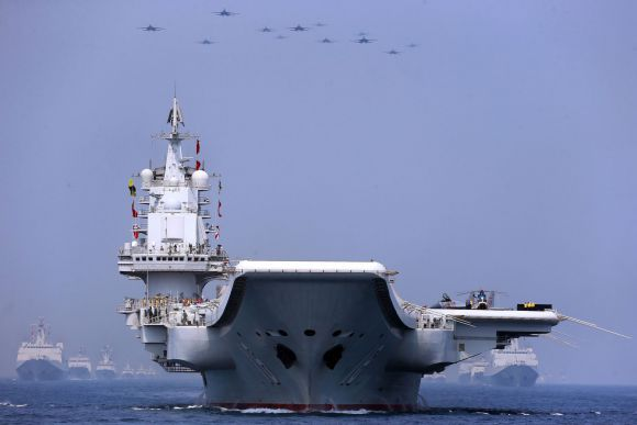 Aircraft carrier Liaoning participates in maritime parade